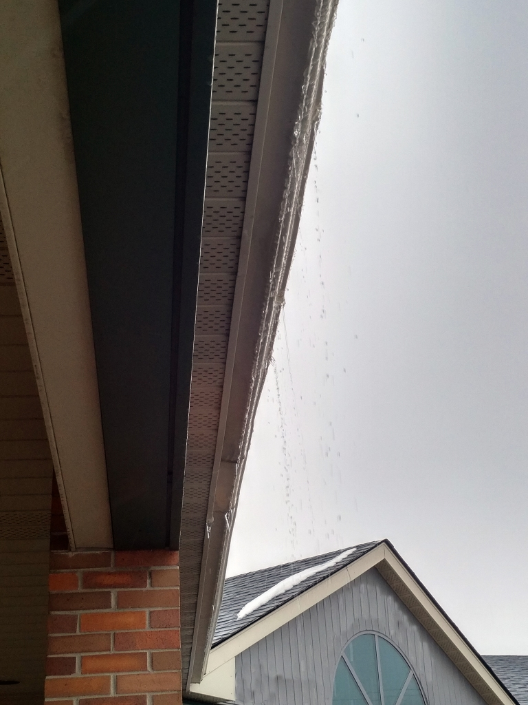 rain dripping from an eaves trough